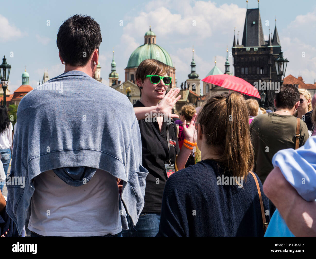 Tourists in Prague  accompanied by a guide on Charles Bridge - Stock Image