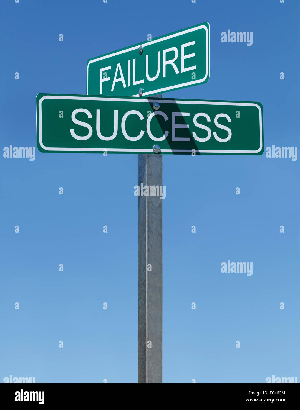 Two Green Street Signs Failure and Success on Metal Pole with Blue Sky Background. - Stock Image