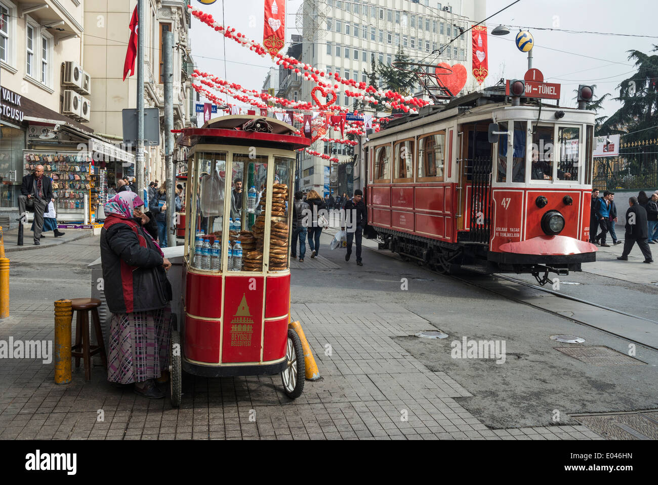 Simit bread vendor and tram in Istiklal Caddesi, Beyoglu, Istanbul, Turkey, - Stock Image