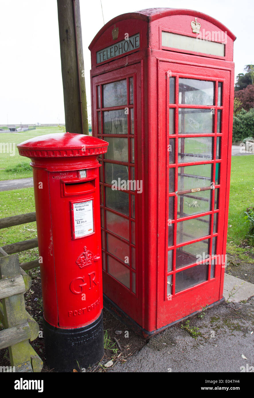 A red classic English phone box and post box in Clevedon, North Somerset, England, UK - Stock Image