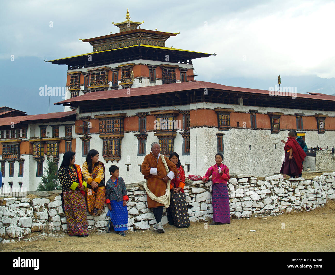 A Bhutanese family dress in ghos pose at the Paro Dzong,Bhutan - Stock Image
