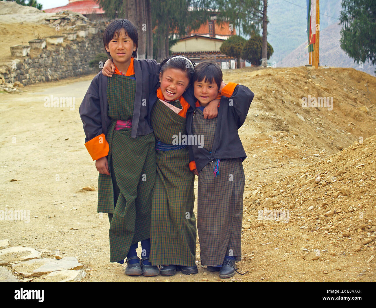 Three Bhutanese school children in Paro - Stock Image