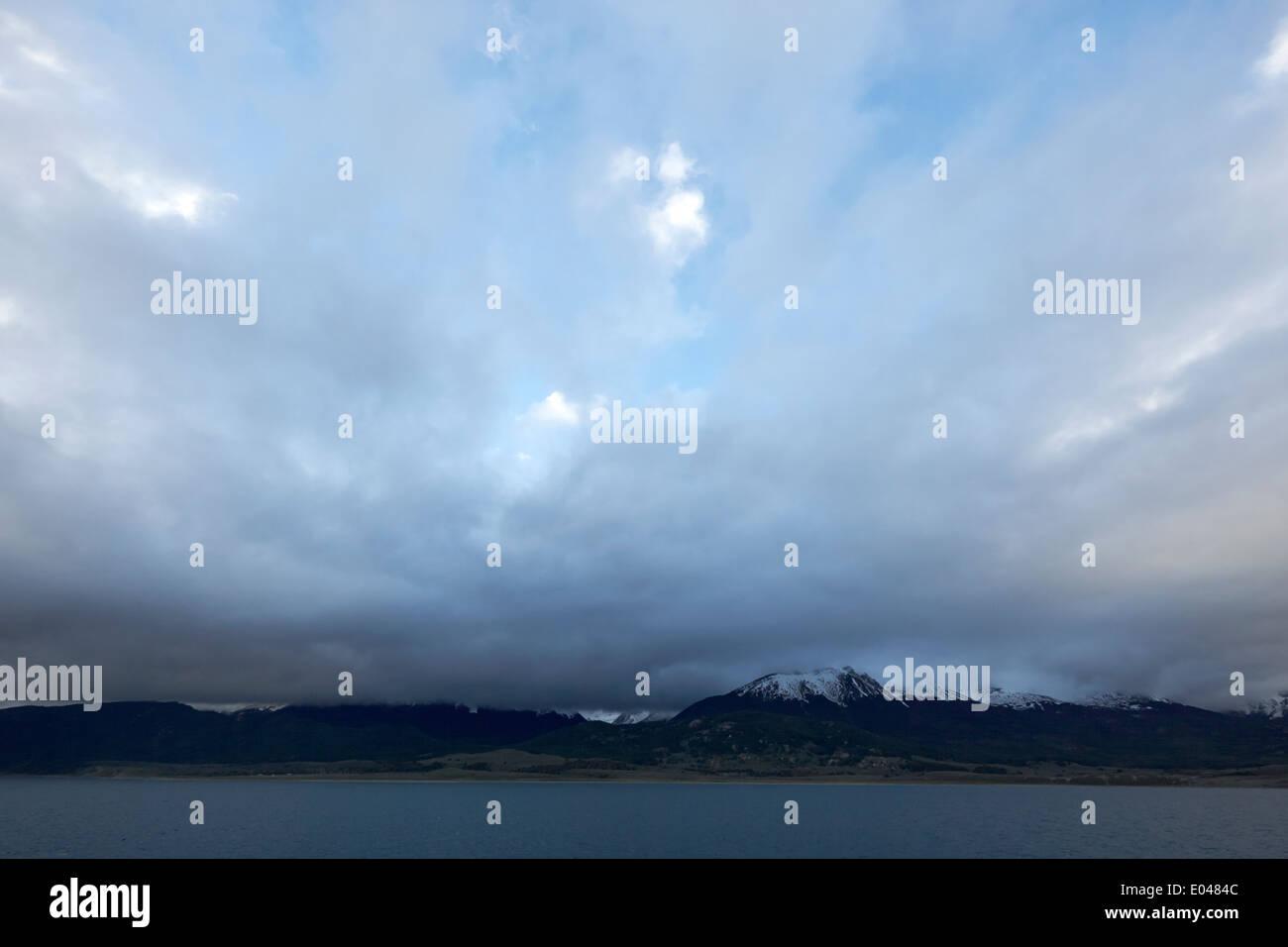 dark clouds over the Beagle Channel and Isla Navarino Tierra Del Fuego Chile - Stock Image