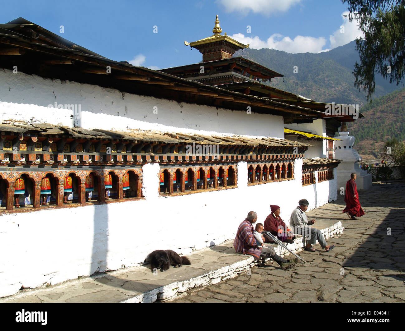 Monks and local people at the Kichu Monastery in Paro,Bhutan - Stock Image