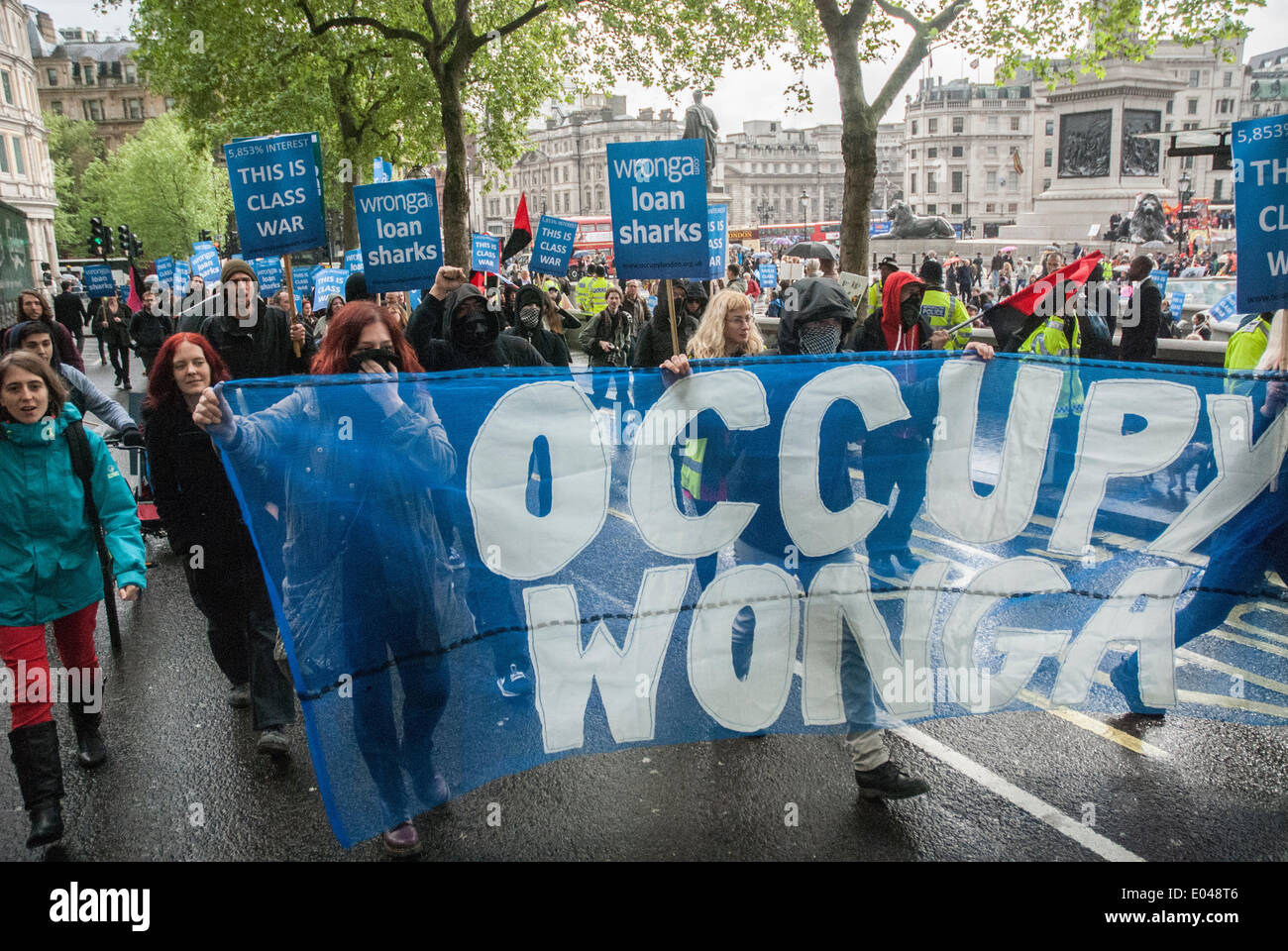 London, UK. 01st May, 2014. The Occupy Wonga group breaks away during the 2014 May Day rally in central London, the group is heading for the London office of WDFC UK Limited to protest against pay day loans that the company provides under the trading name wonga.com Credit:  Peter Manning/Alamy Live News - Stock Image