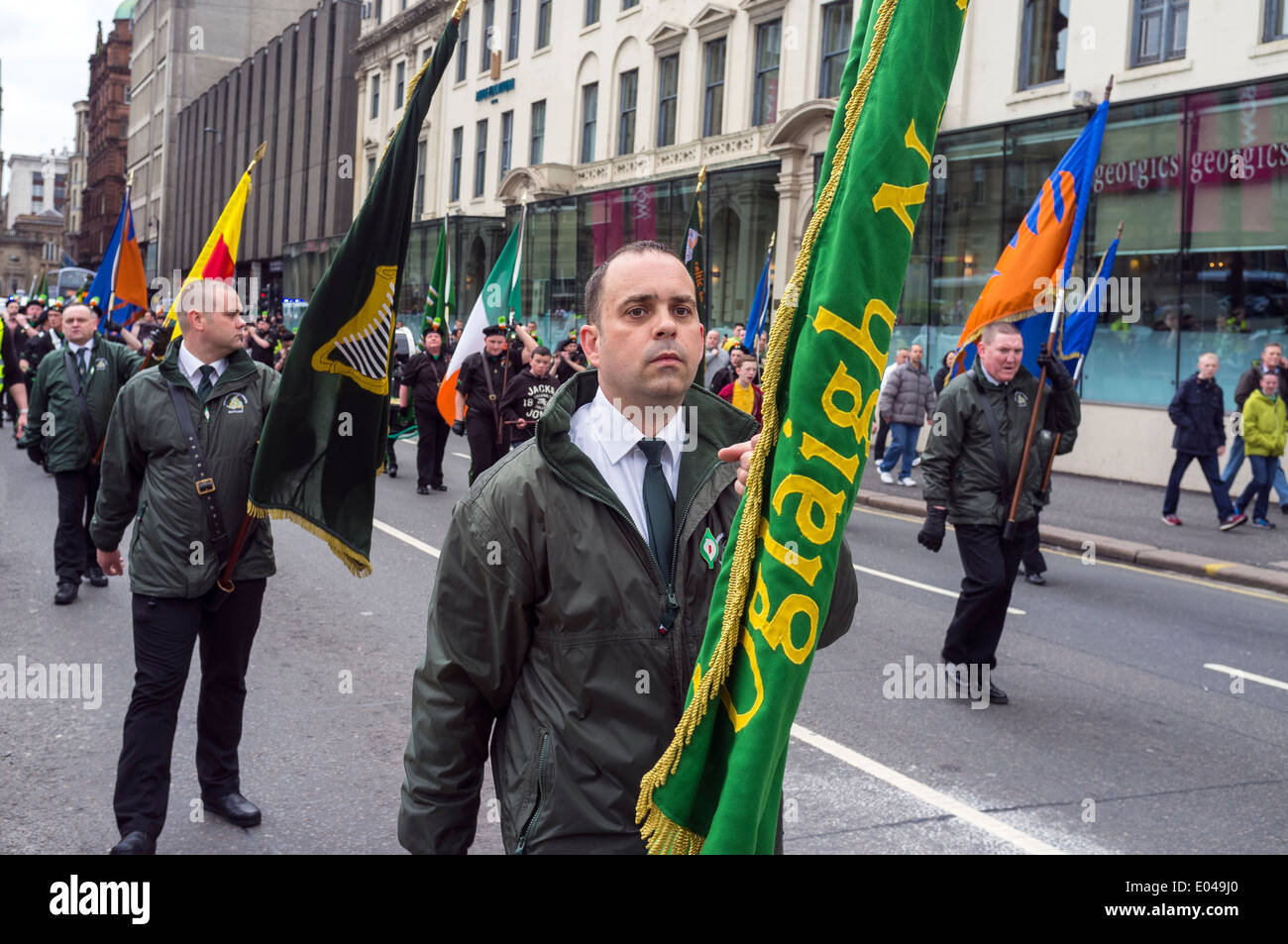 Members of the pro-Irish republican supporting Cairde na Heireann organisation parading through Glasgow city Scotland, UK - Stock Image