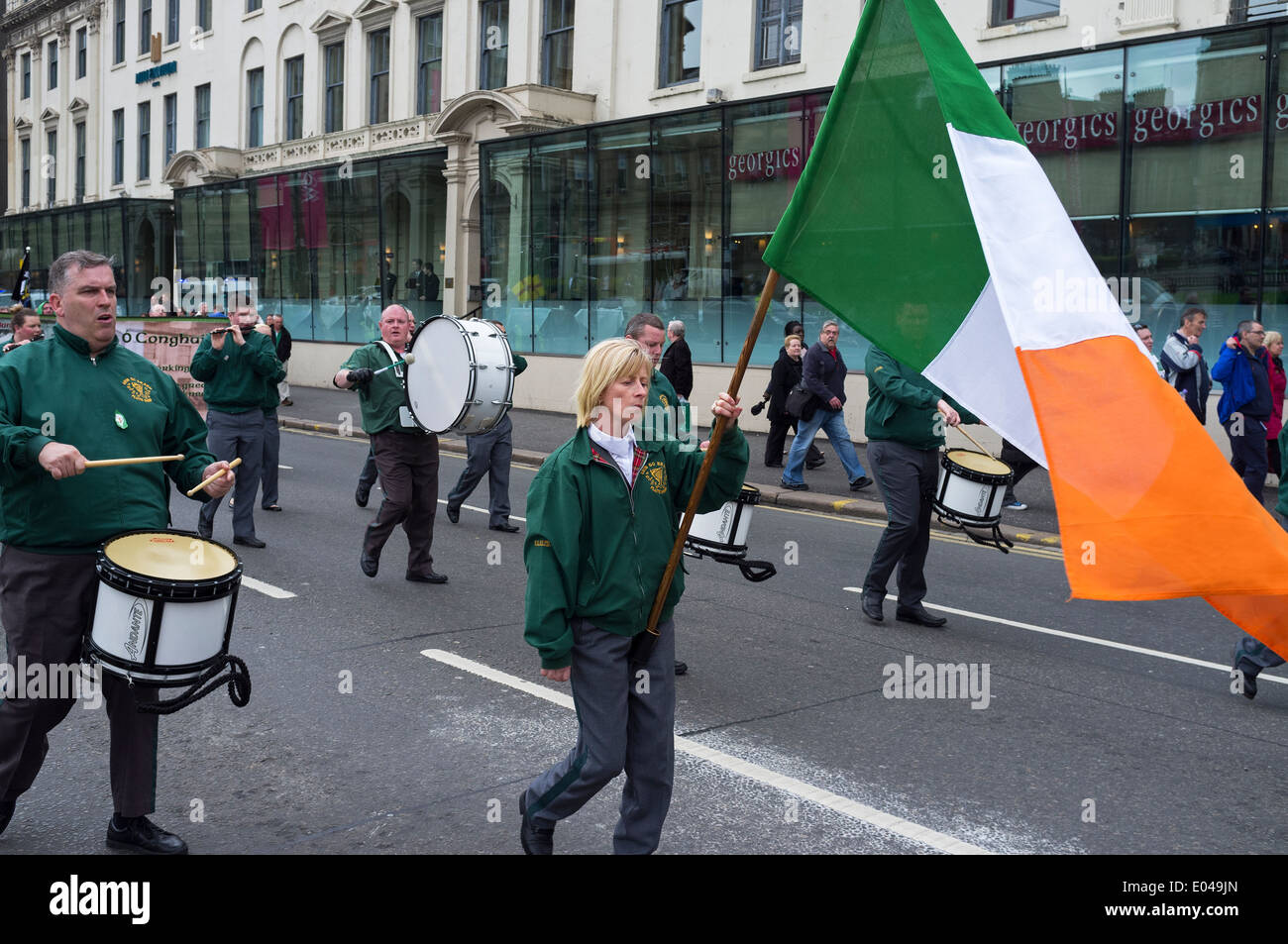 Members of the pro-Irish republican supporting Cairde na Heireann organization parading through Glasgow city  Scotland, UK - Stock Image
