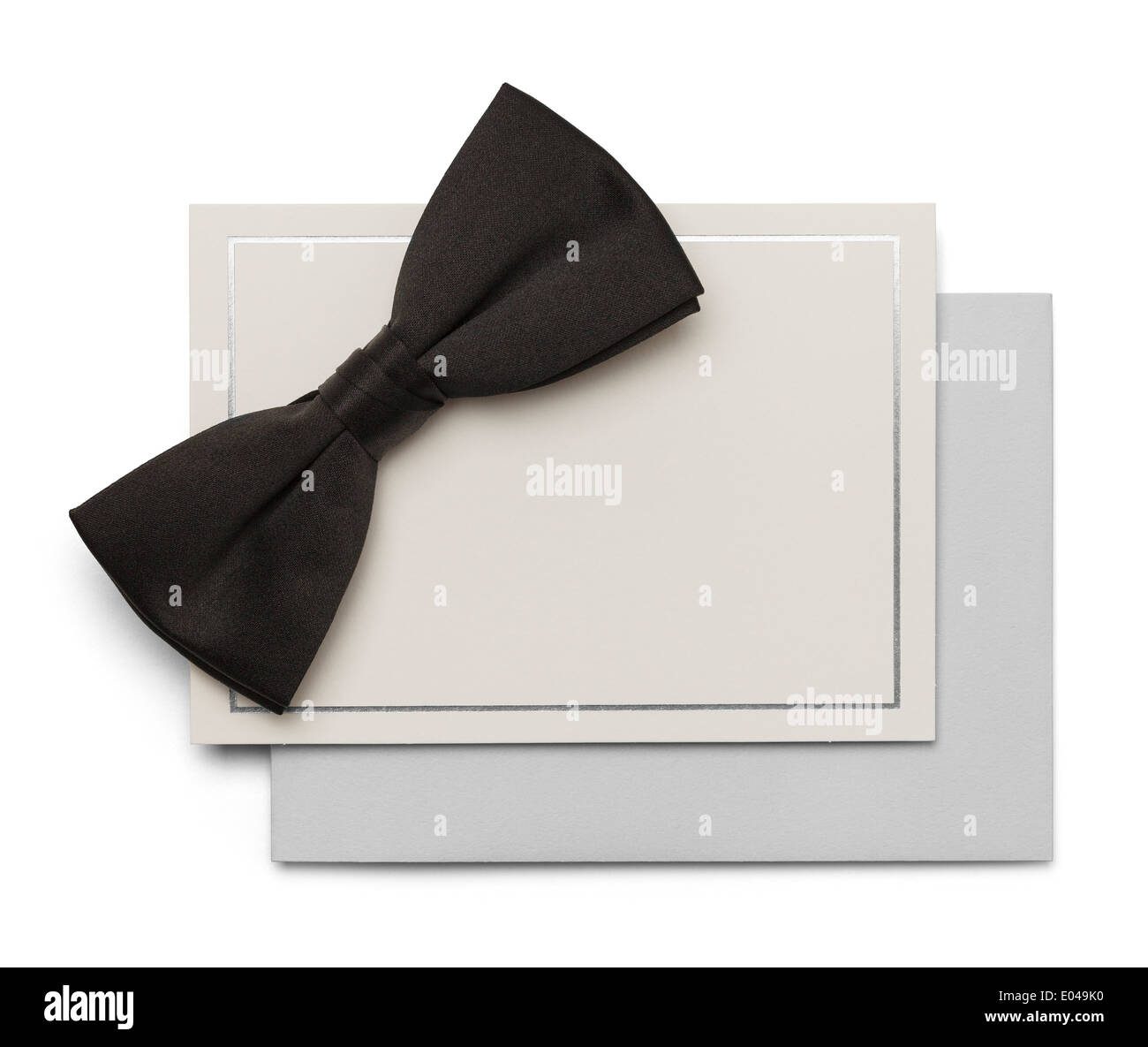 Black Bow Tie with Card and Envelope isolated on White Background. - Stock Image