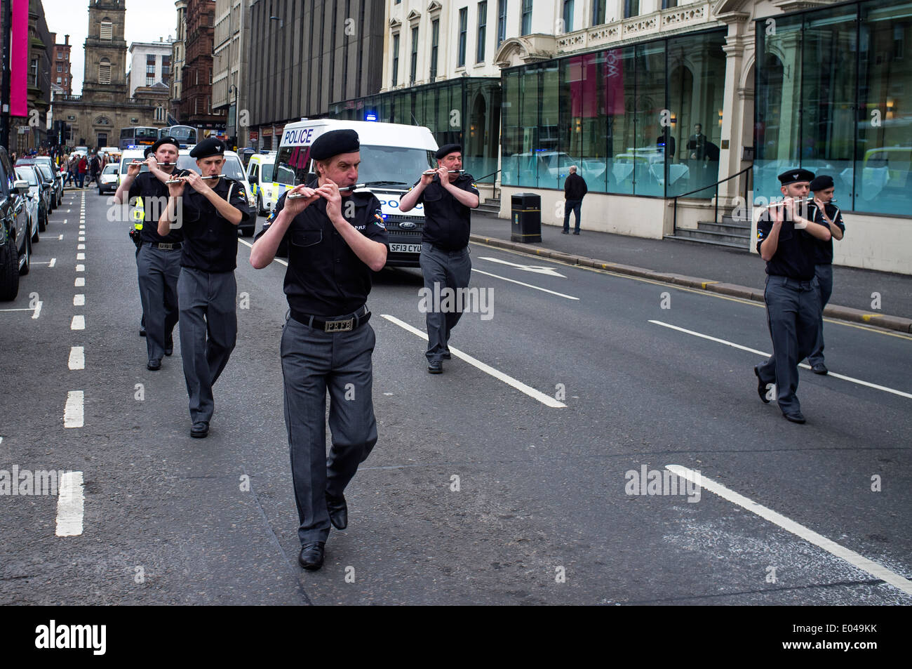 Members of the pro-Irish republican supporting Cairde na Heireann organization parading through Glasgow city, Scotland, UK - Stock Image