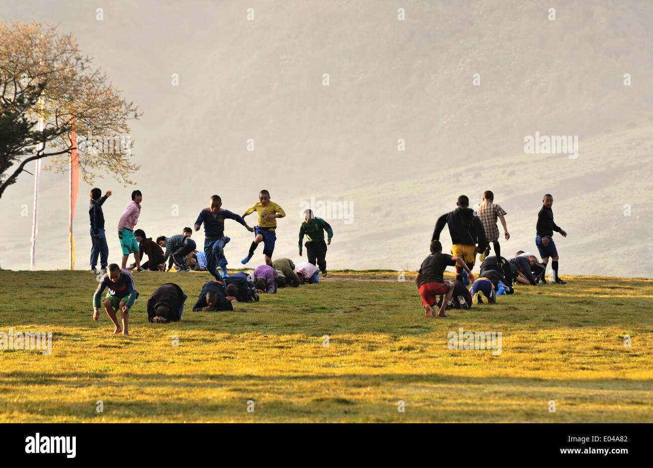 Kids exercising in the school playground, village of Sakteng, Eastern Bhutan - Stock Image