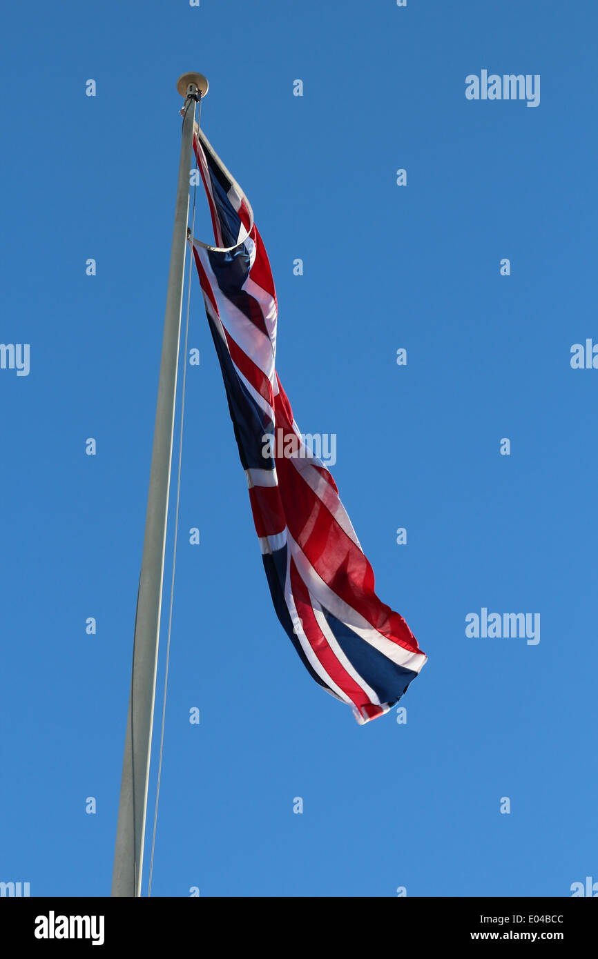 Union Jack Flag flying remembrance service - Stock Image