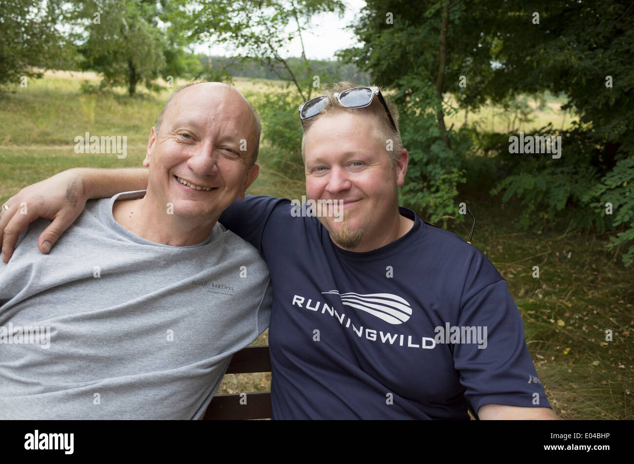 Respectful son-in-law has arm around his fun loving Polish pop. Zawady Central Poland - Stock Image