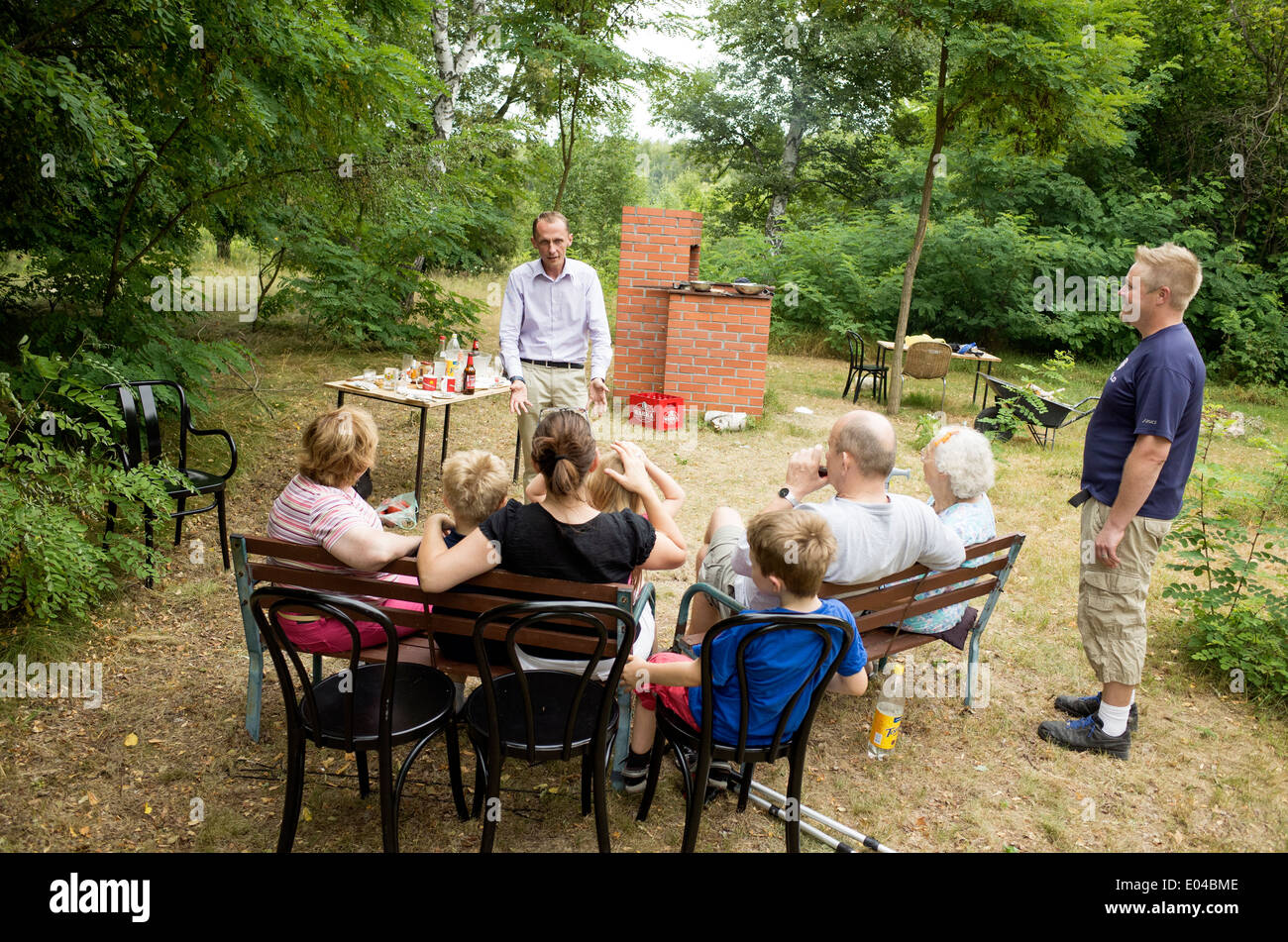 Polish family listens to financier discuss various land options. Zawady Central Poland - Stock Image