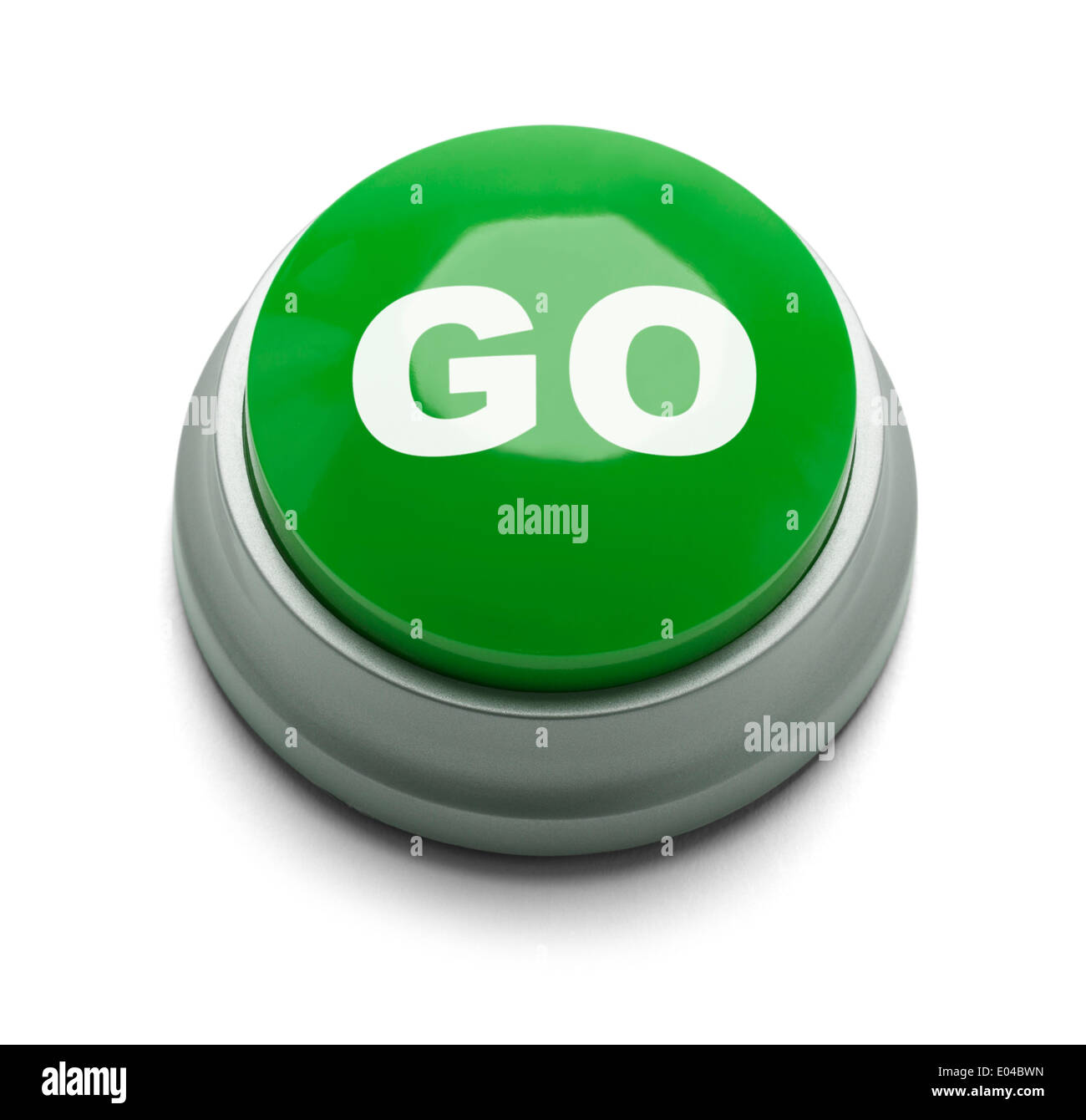 Large green button with the word go on it isolated on a white background. - Stock Image