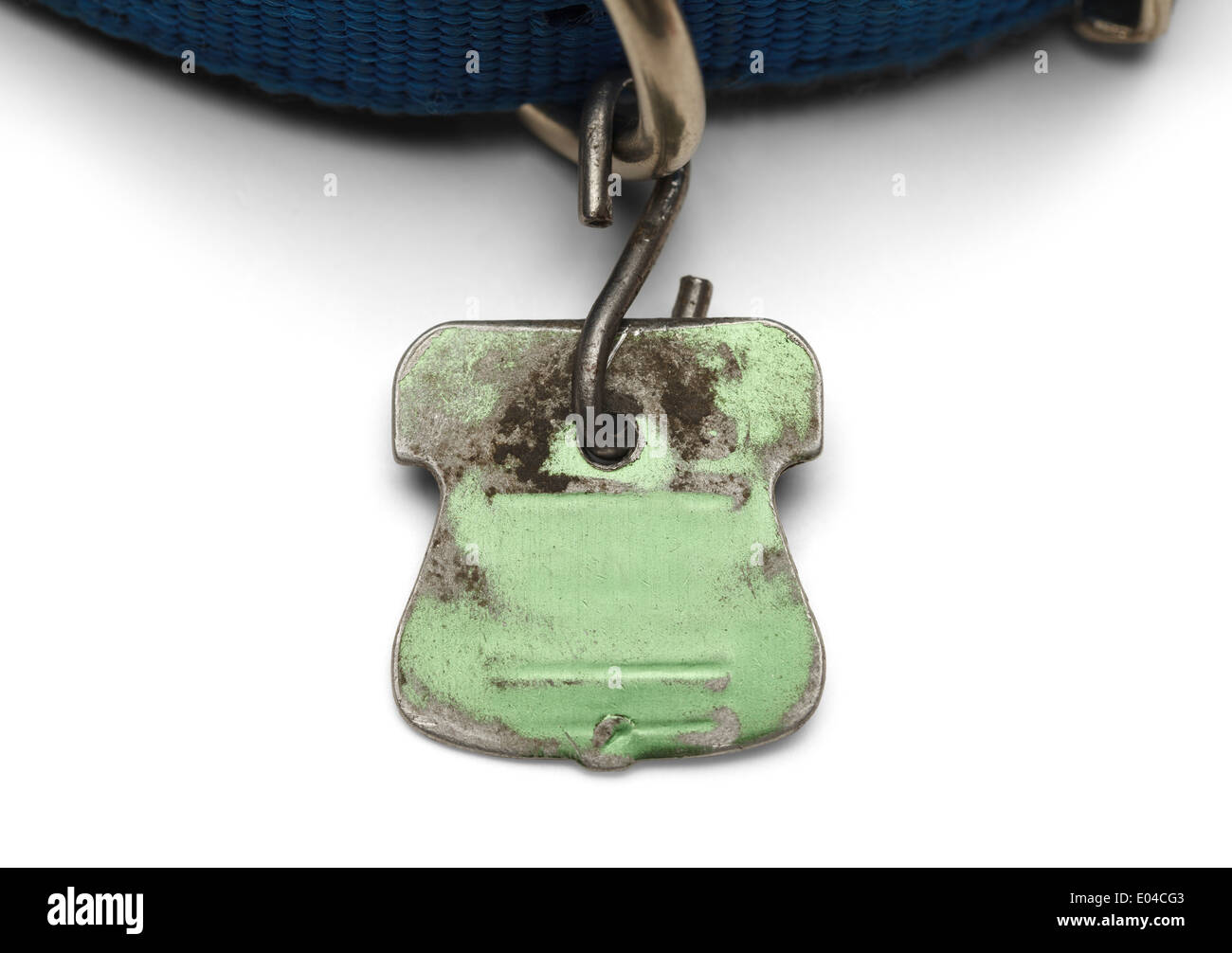 Blank Pet Dog Tag Shield Worn out and Scratched Isolated on White Background. Stock Photo