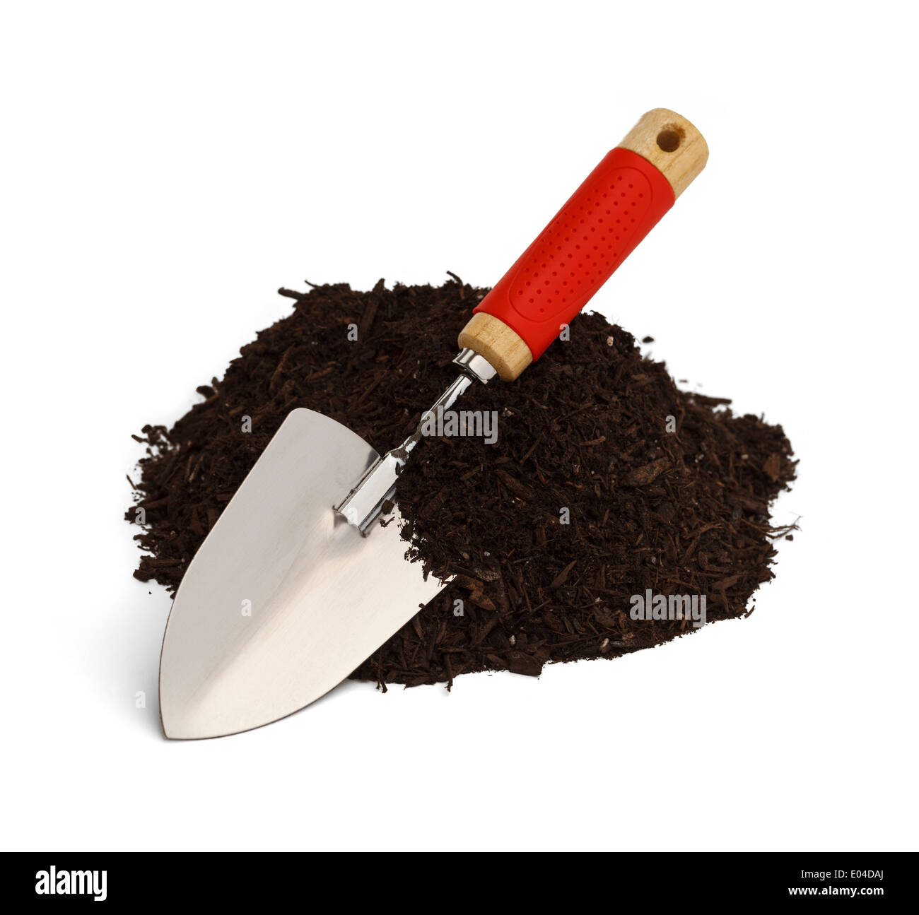 Pile of Dirt with Shovel Isolated on White Background. - Stock Image