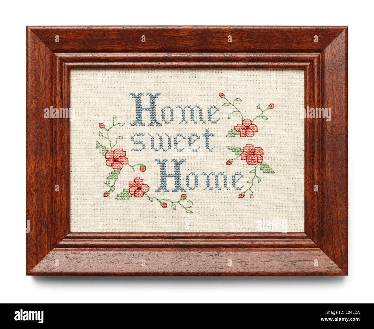 Cross Stitch in Wood Frame Isolated on White Background. - Stock Image