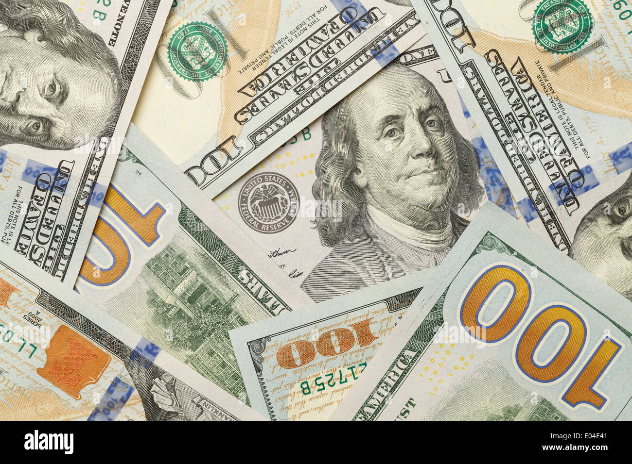 New One Hundred Dollar Bills in Scattered Pile Laying Flat. - Stock Image