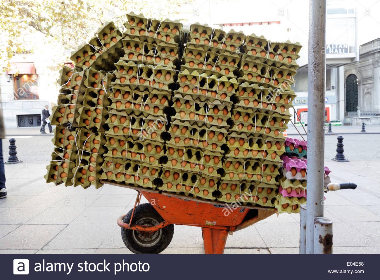 wheelbarrow loaded with eggs - Stock Image