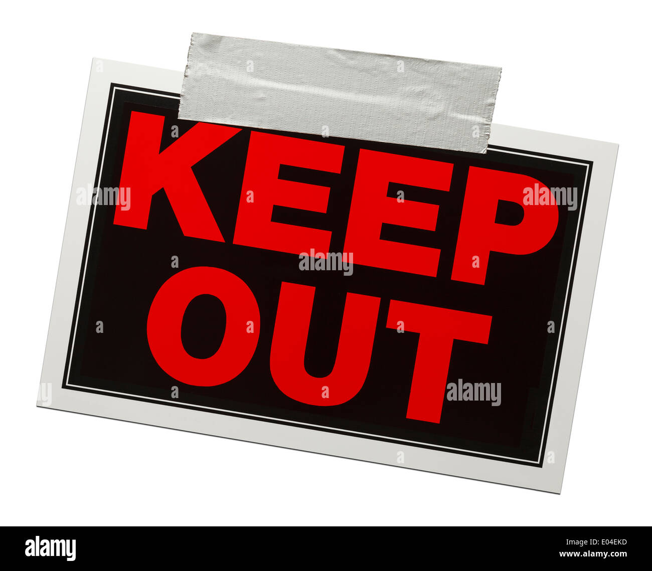 Red and black keep out sign with tape holding it up isolated on a white background. - Stock Image