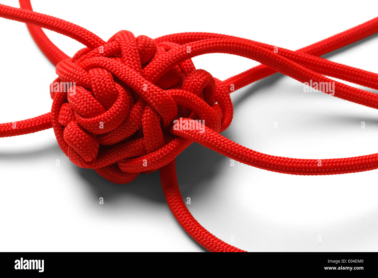 Red Rope in A Tangled Mess Isolated on White Background. - Stock Image