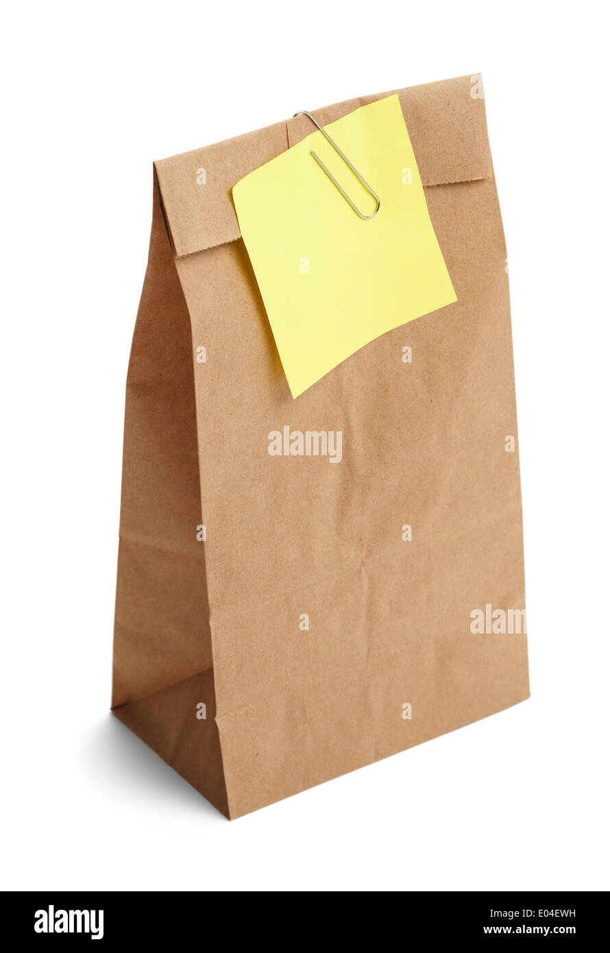 Brown paper bag with yellow note held on with paper clip isolated on white background. - Stock Image