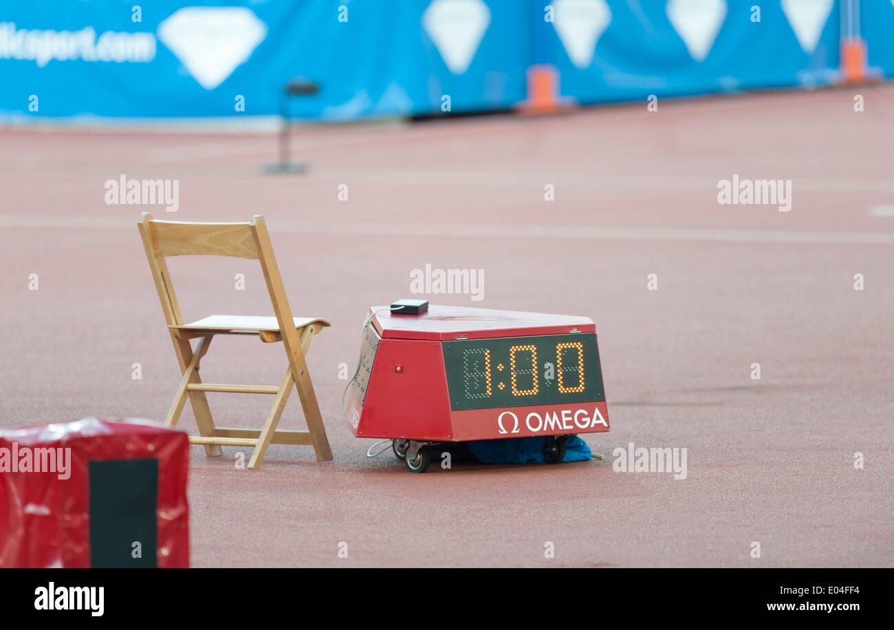 Empty referee's chair and timetaking equipment next to the track at Zurich (Switzerland) Letzigrund athletics stadium - Stock Image