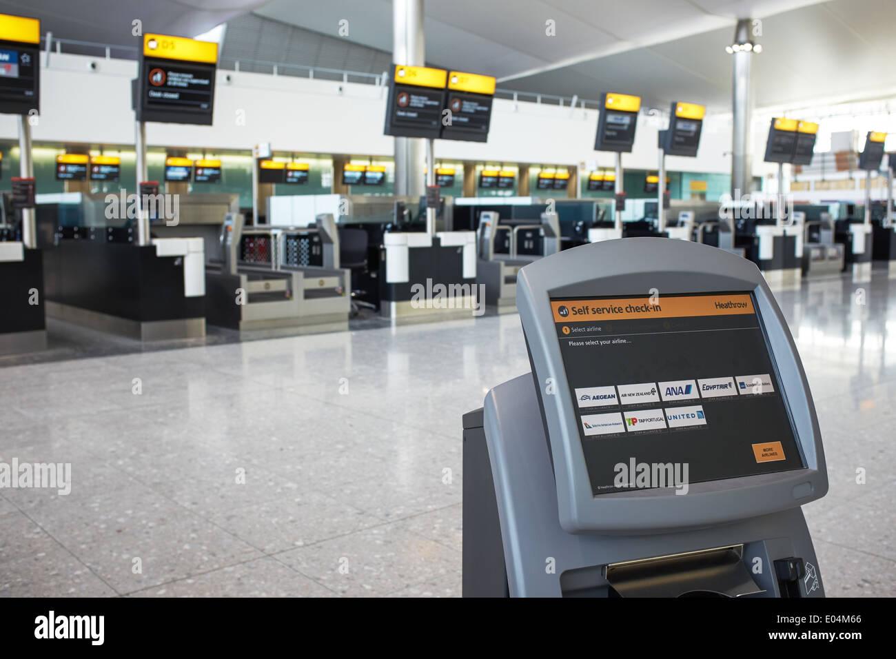 London Heathrow airport terminal 2 Self Service Check In terminal - Stock Image