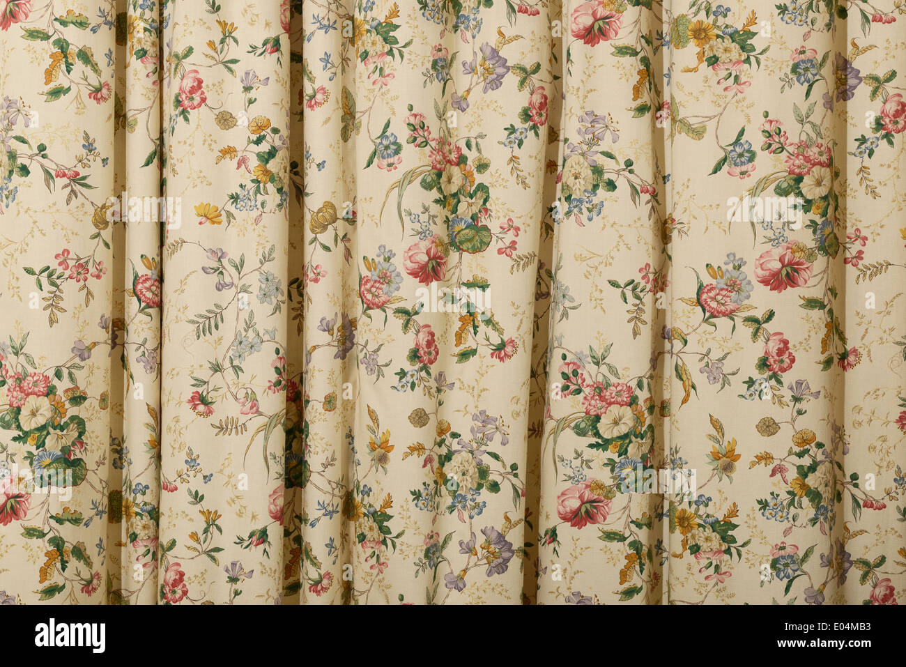 Floral chintz curtains - Stock Image