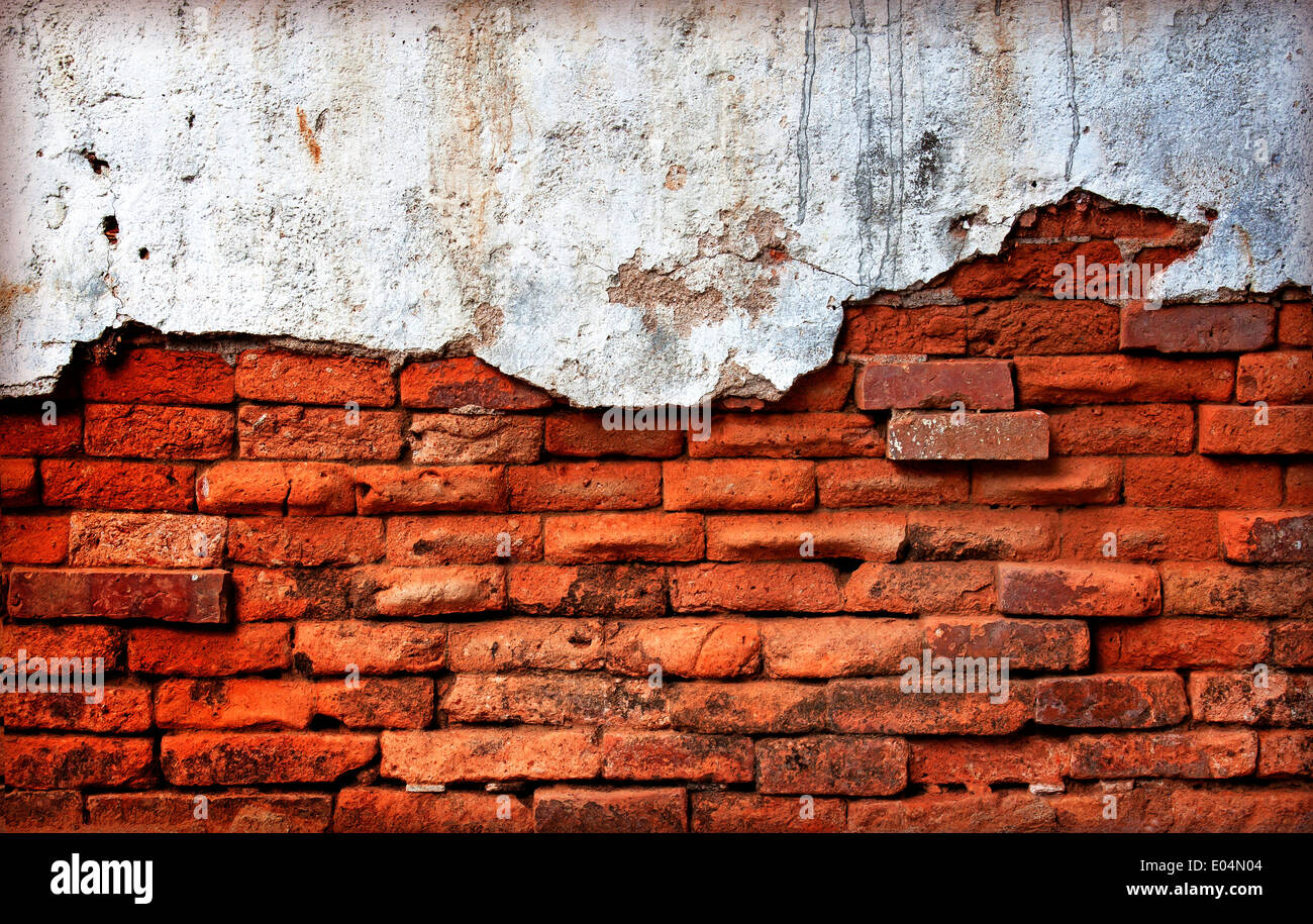 Old red brick wall damage decay erosion. Stock Photo