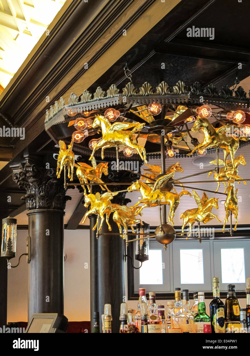 Golden rotating pegasus chandelier in bar room newly renovated golden rotating pegasus chandelier in bar room newly renovated tavern on the green restaurant nyc usa aloadofball Gallery