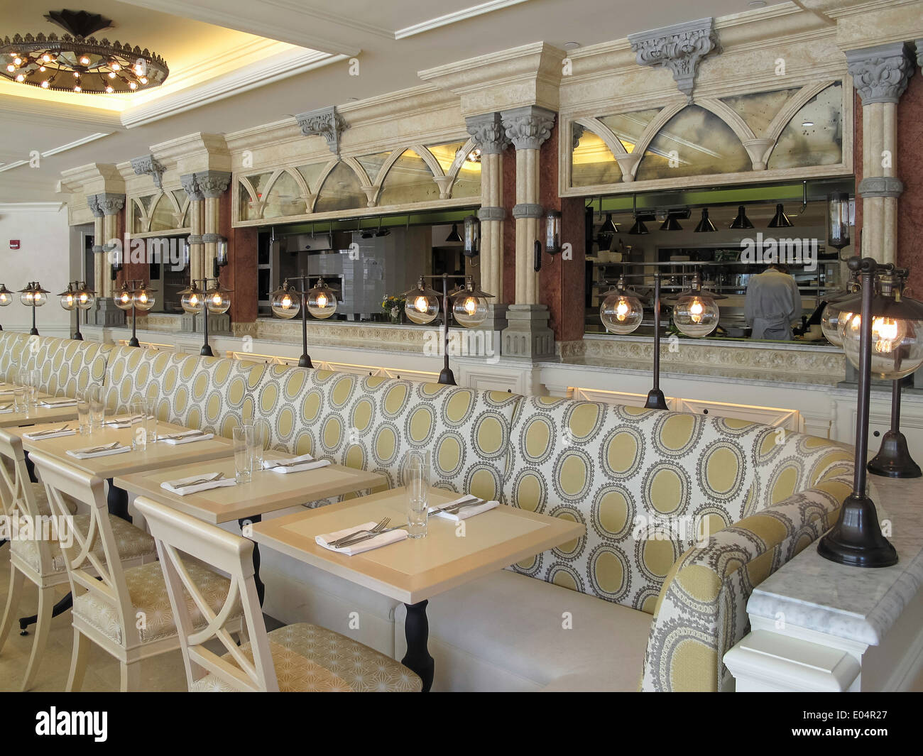 Banquette and tables in dining room with open kitchen access newly renovated tavern on the green restaurant nyc usa