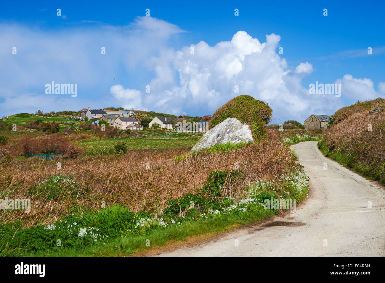 twisting winding road at Bryher, Isles of Scilly, Scillies, Cornwall in April - Stock Image