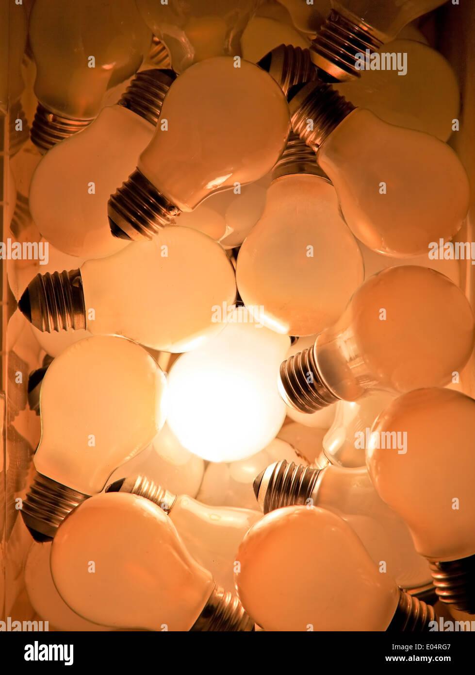 Many light bulbs, one shines, symbol for ideas, Viele Gluehbirnen, eine leuchtet,Symbol fuer Ideen - Stock Image