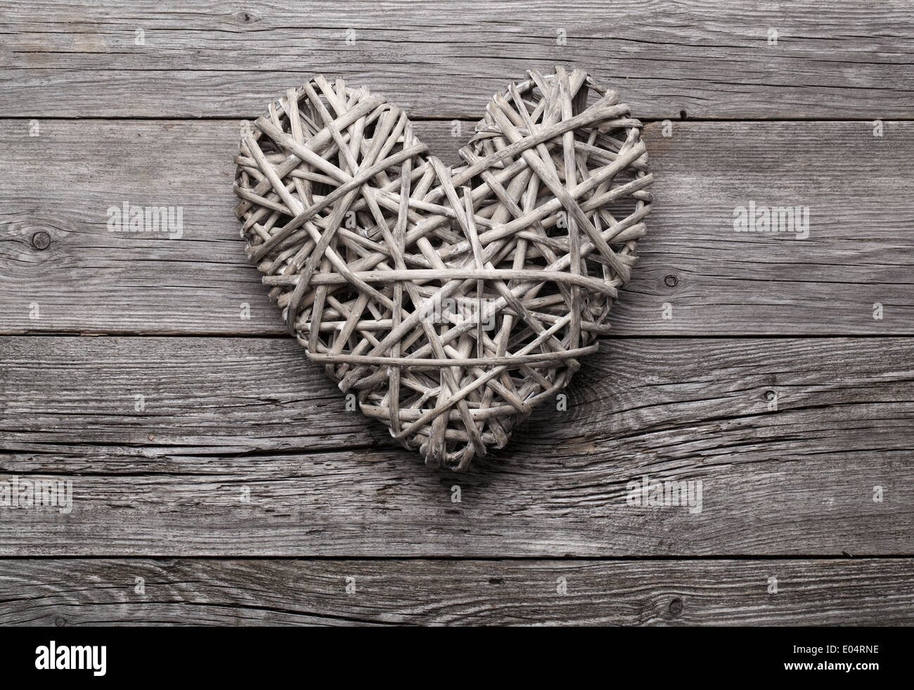 Heart shaped decoration made of straw. - Stock Image