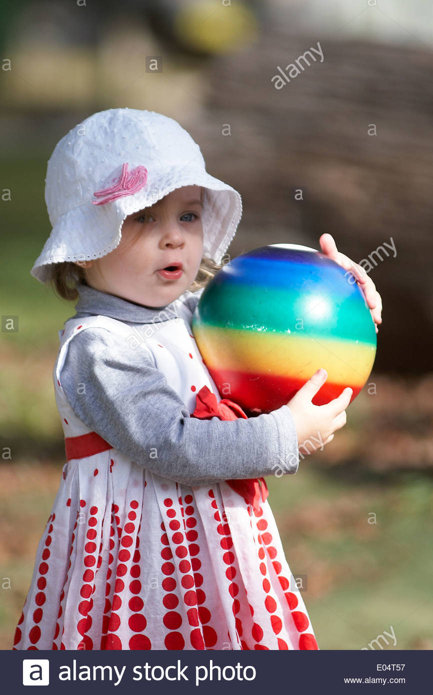 105d3a47f08 A little girl wearing a white floppy hat