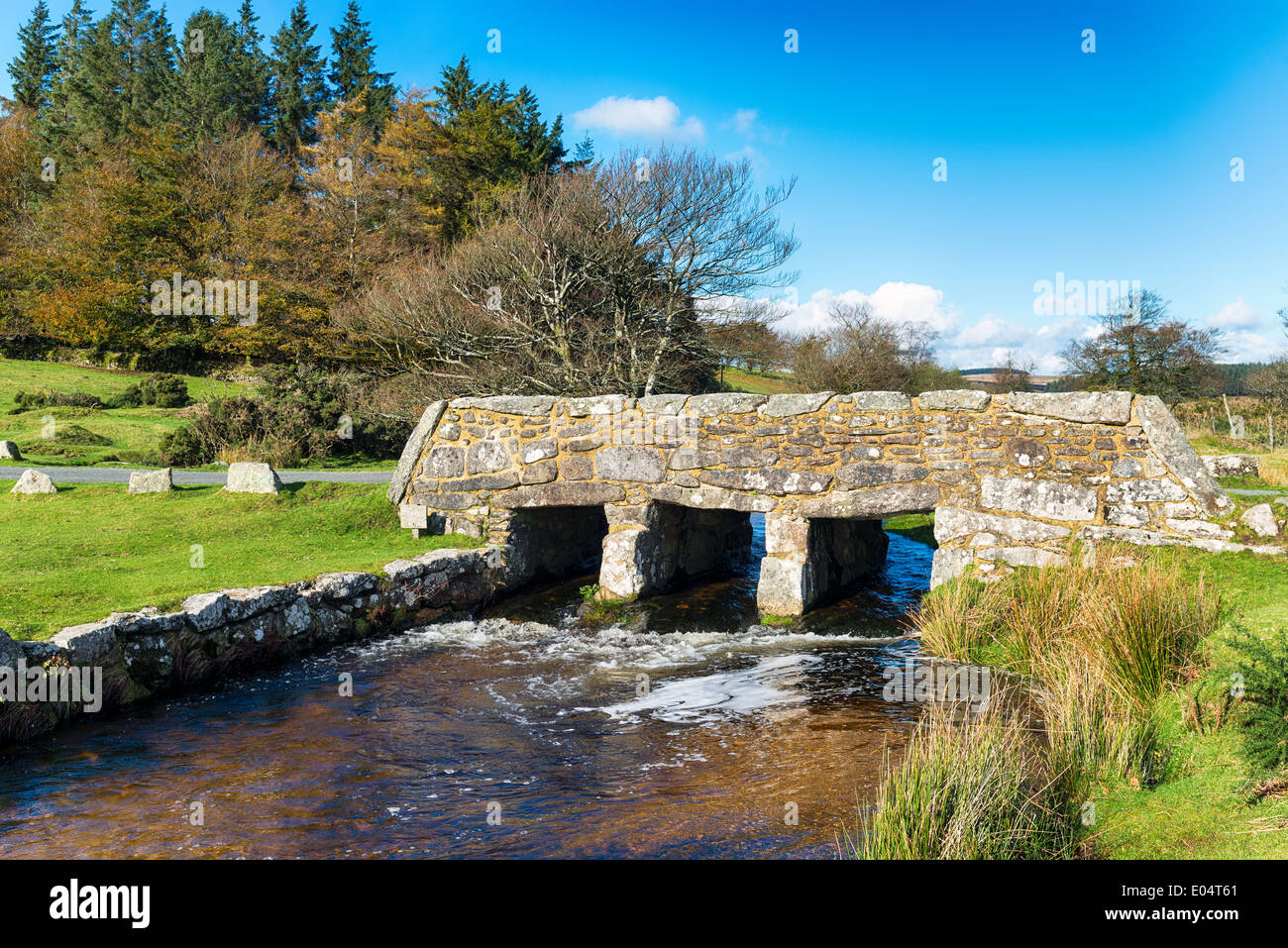 An old stone bridge over Walla Brook near Bellever on Dartmoor National Park in Devon - Stock Image