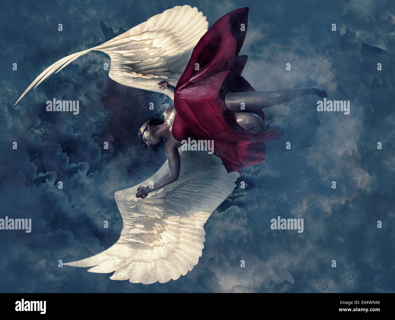 Woman with angel wings falling through the sky - Stock Image