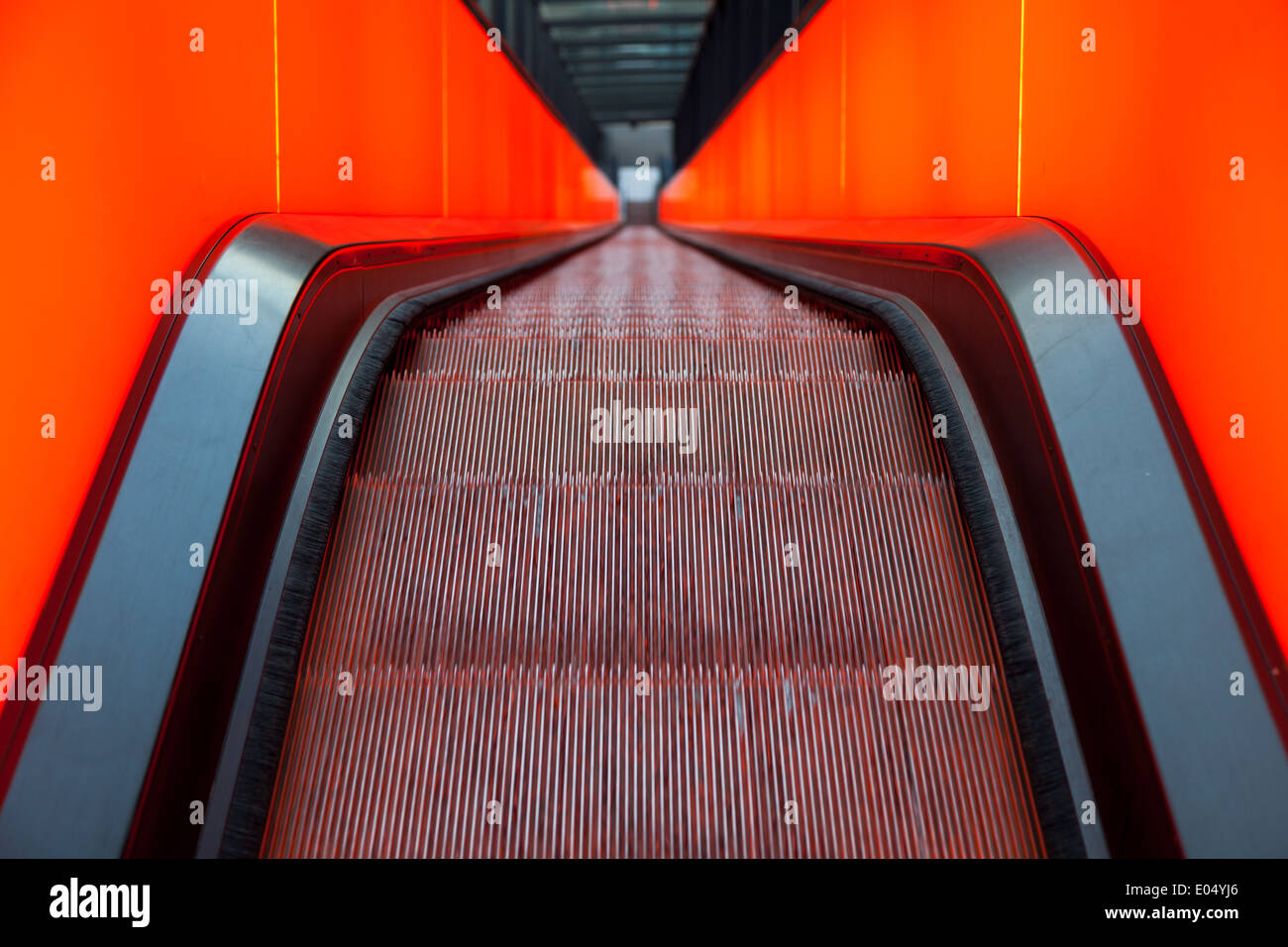 Neon lit escalator up to the museum in the main building of the Zeche Zollverein UNESCO heritage - Stock Image