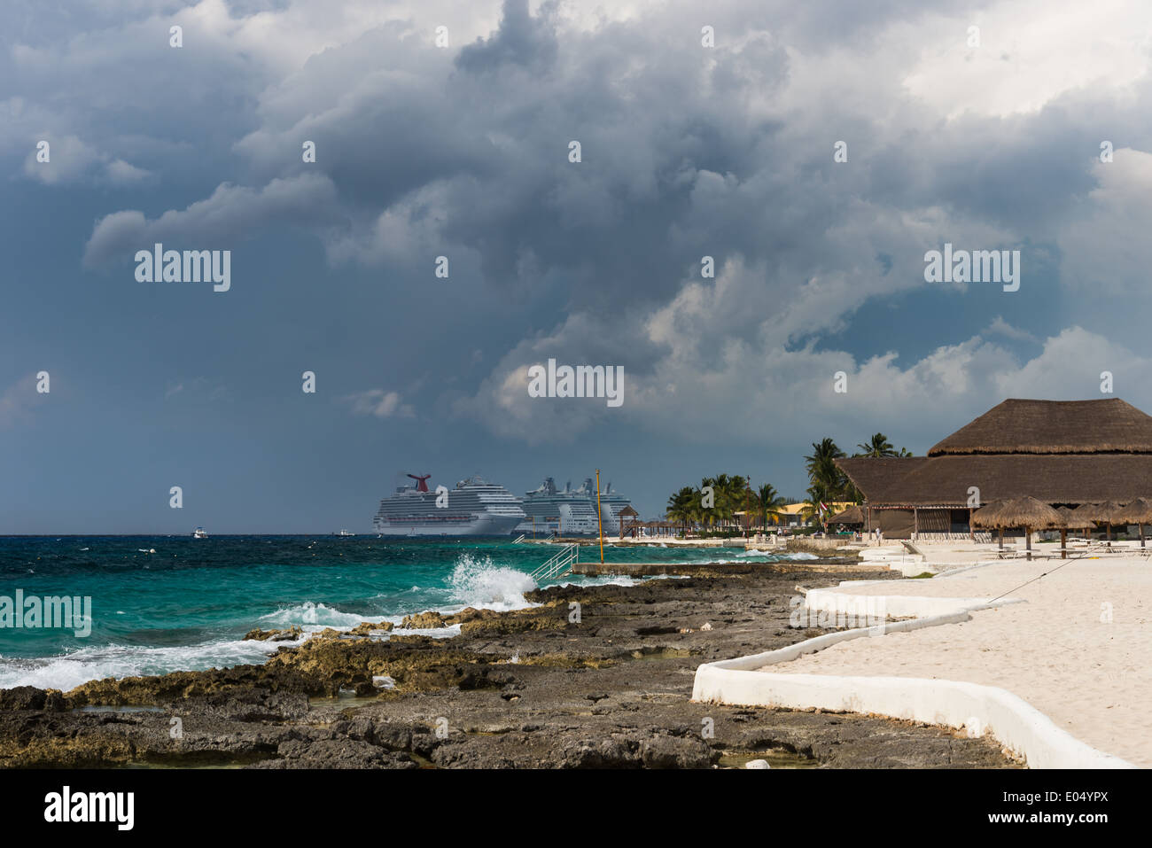 Dark storm clouds gather over a beach resort. Cozumel, Mexico. Stock Photo