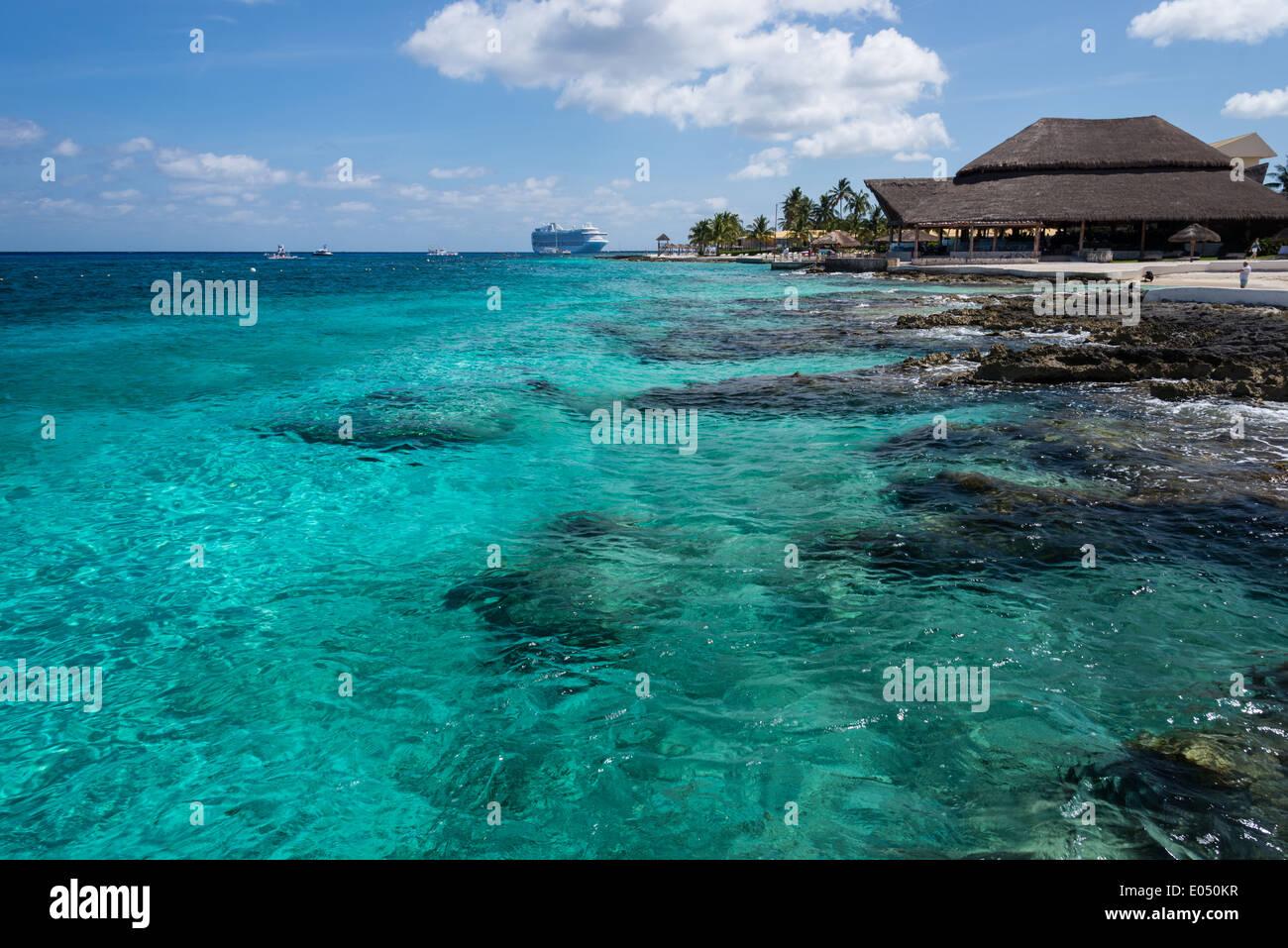 Reef Rocks And Blue Water Around A Luxury Beach Resort