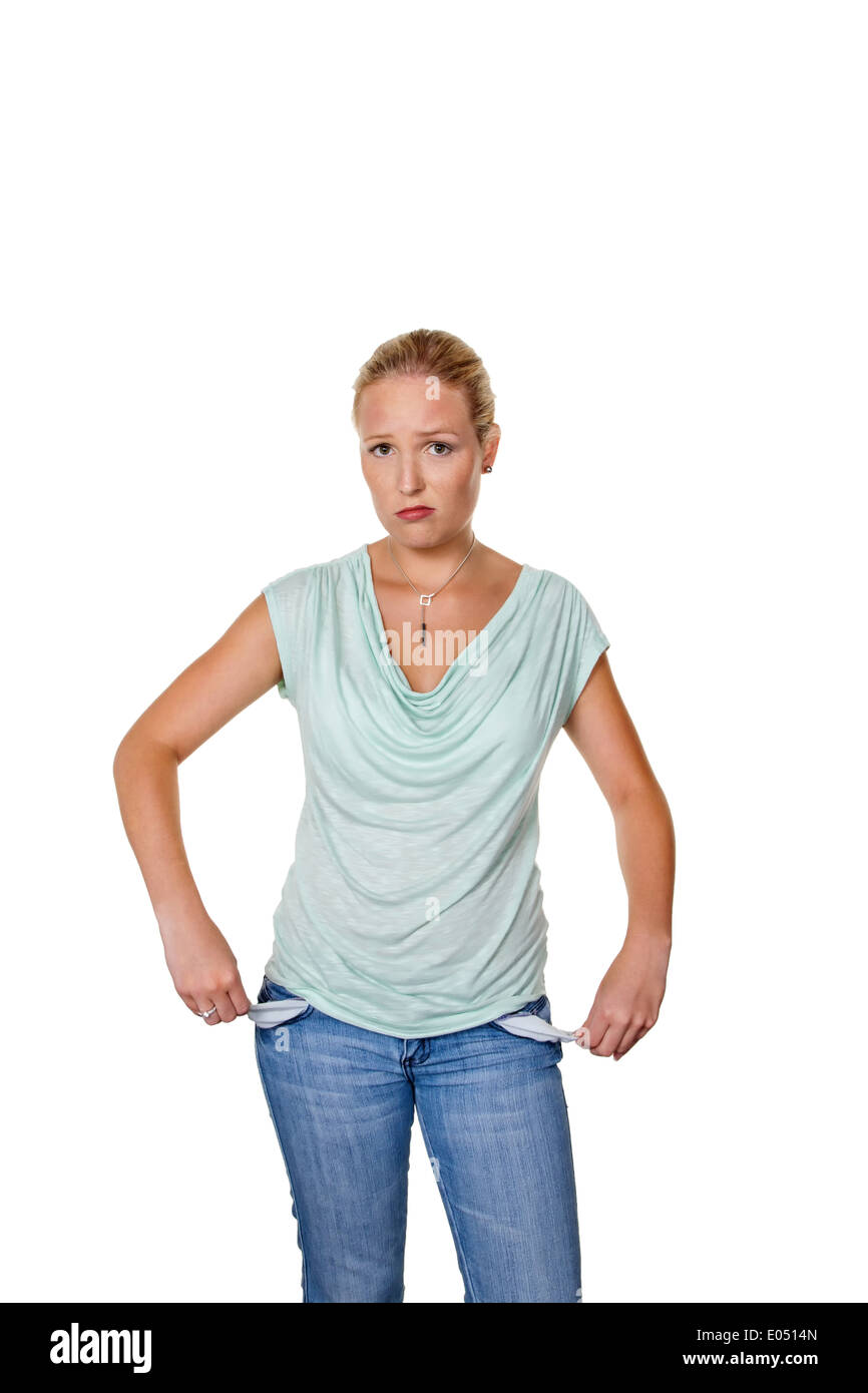 A young woman shows the empty trouser pockets of her jeans. Symbolic photo for debts., Eine junge Frau zeigt die leeren Hosentas - Stock Image