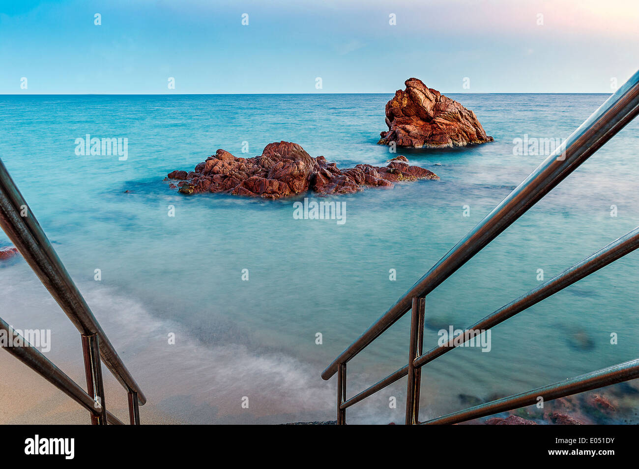 Europe, France, Alpes-Maritimes, Cannes. Red rock at dusk. - Stock Image