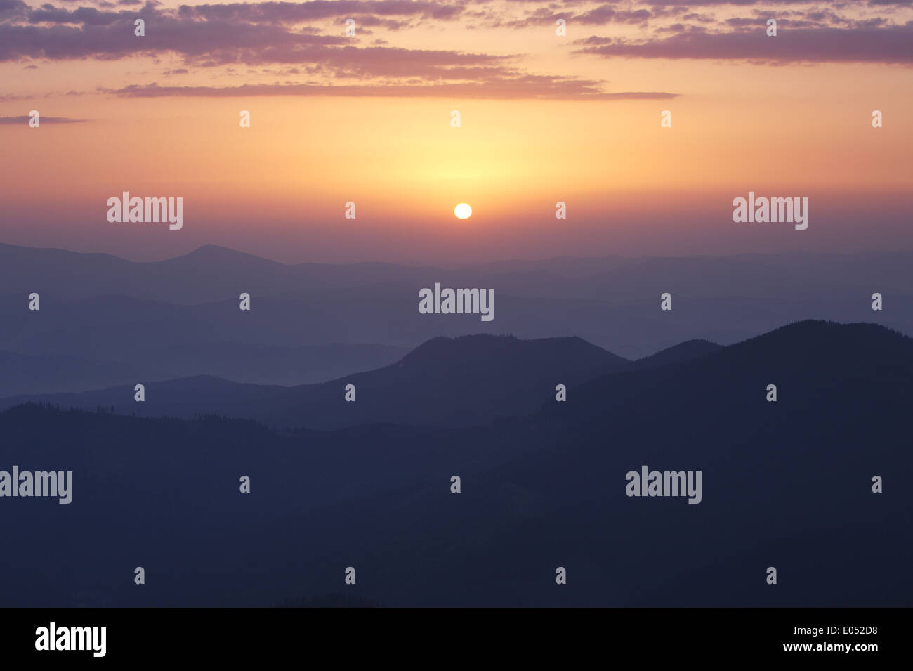 Rising sun under Carpathian mountains, Ukraine - Stock Image