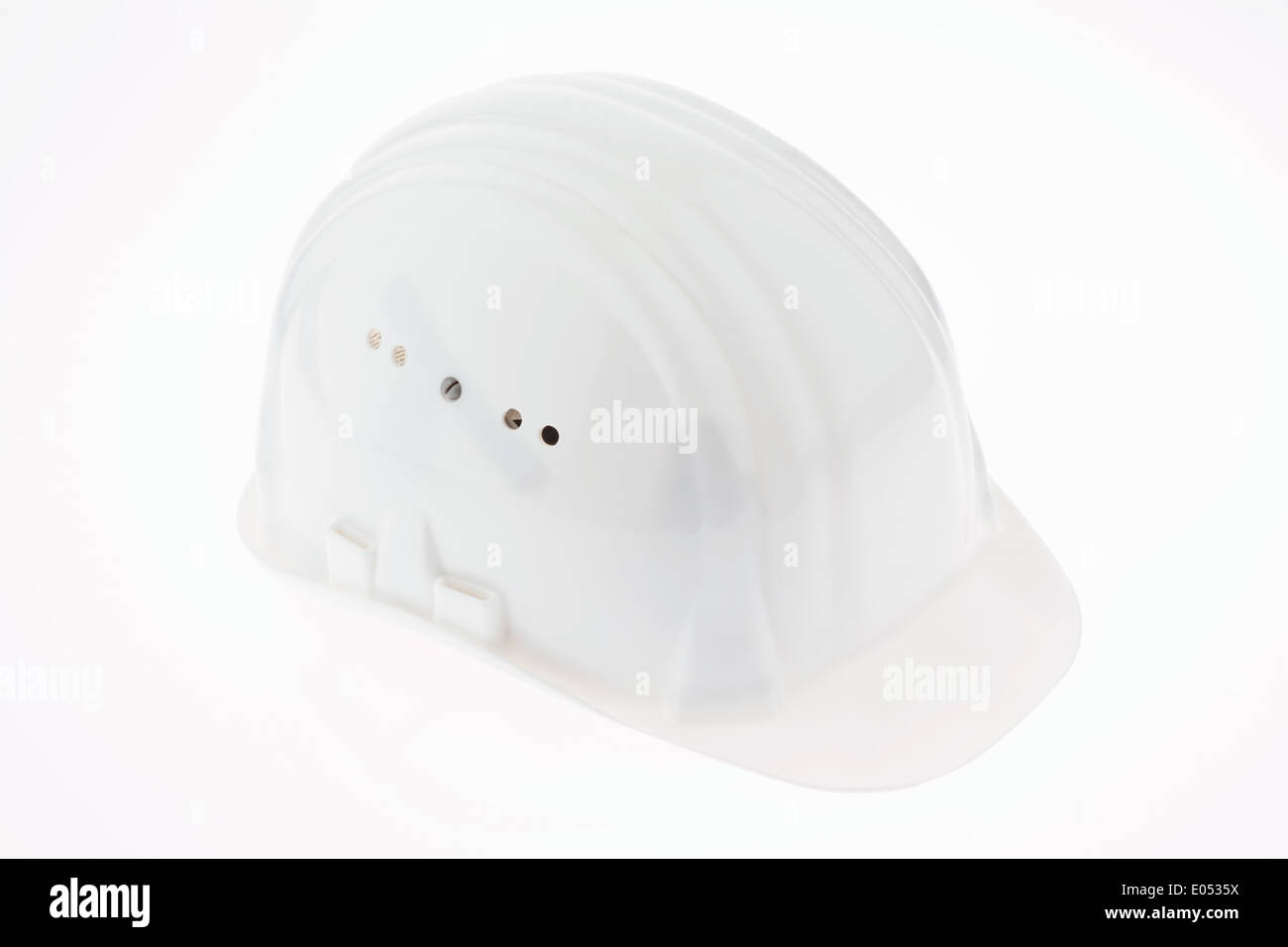 Construction helmet of a site foreman isolates on white background, Bauhelm eines Poliers isoliert auf weissem Hintergrund - Stock Image