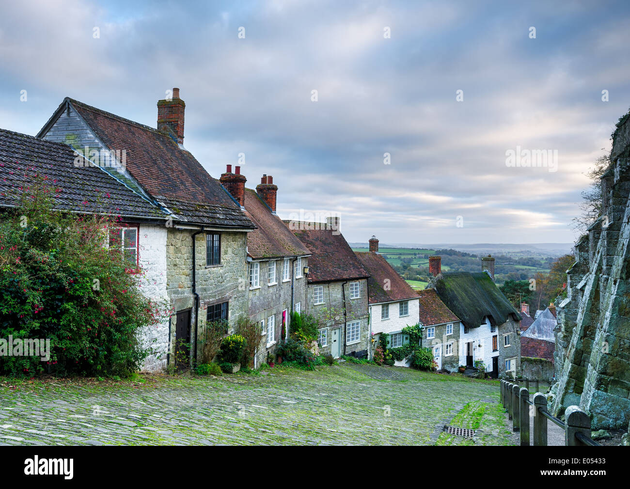 Row of quaint English cottages at Gold Hill in Shaftesbury in Dorset. - Stock Image