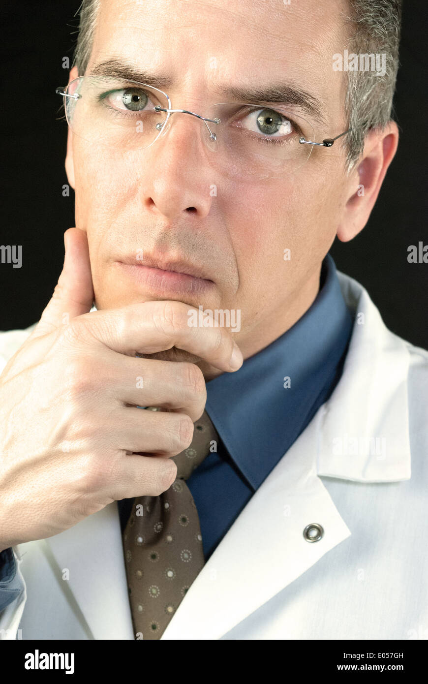 Close-up of a Doctor considering a patients case. - Stock Image