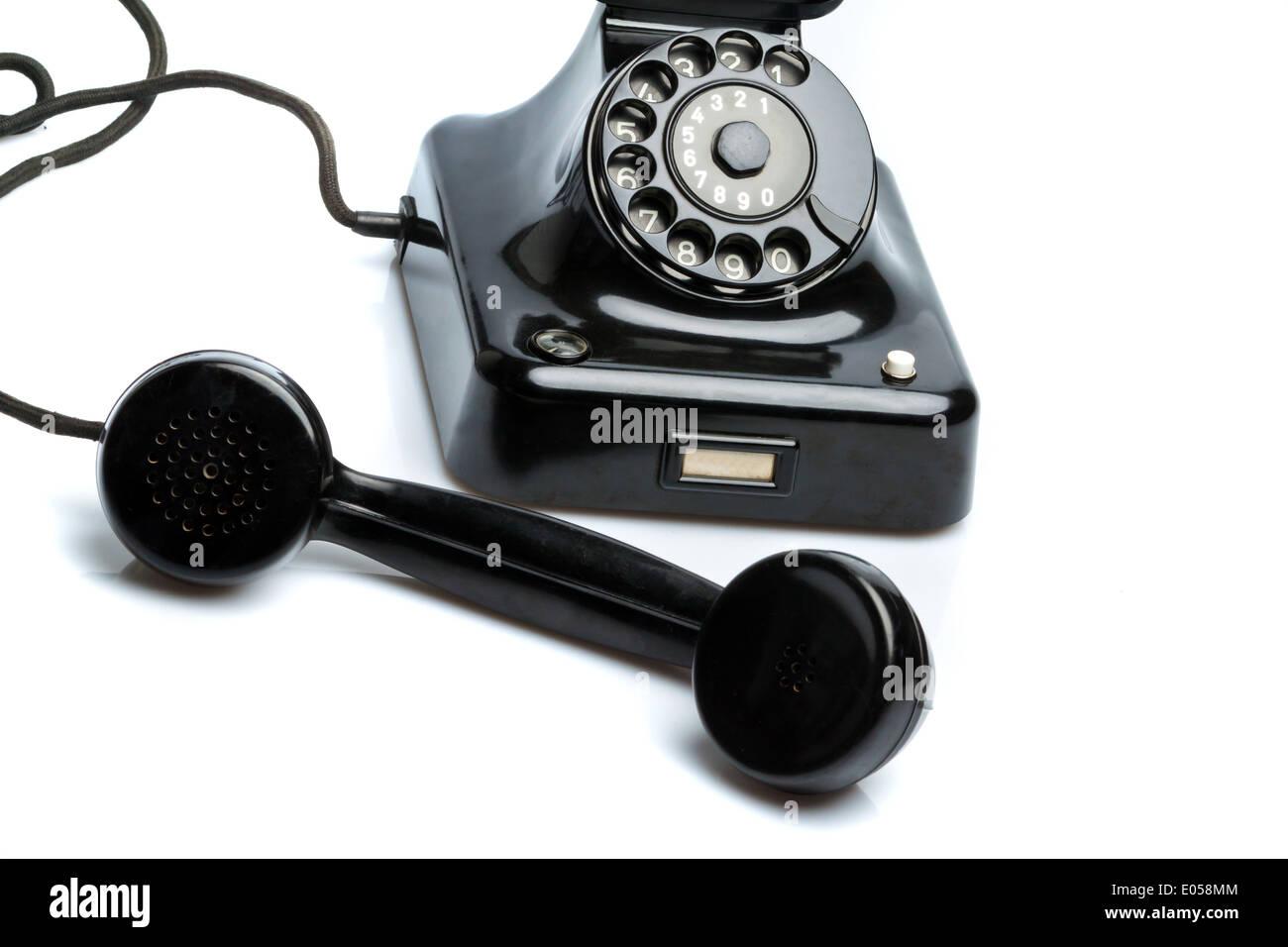 An antique, old fixed network telephone. Phone on white background., Ein antikes, altes Festnetz Telephon. Telefon auf weissem H - Stock Image