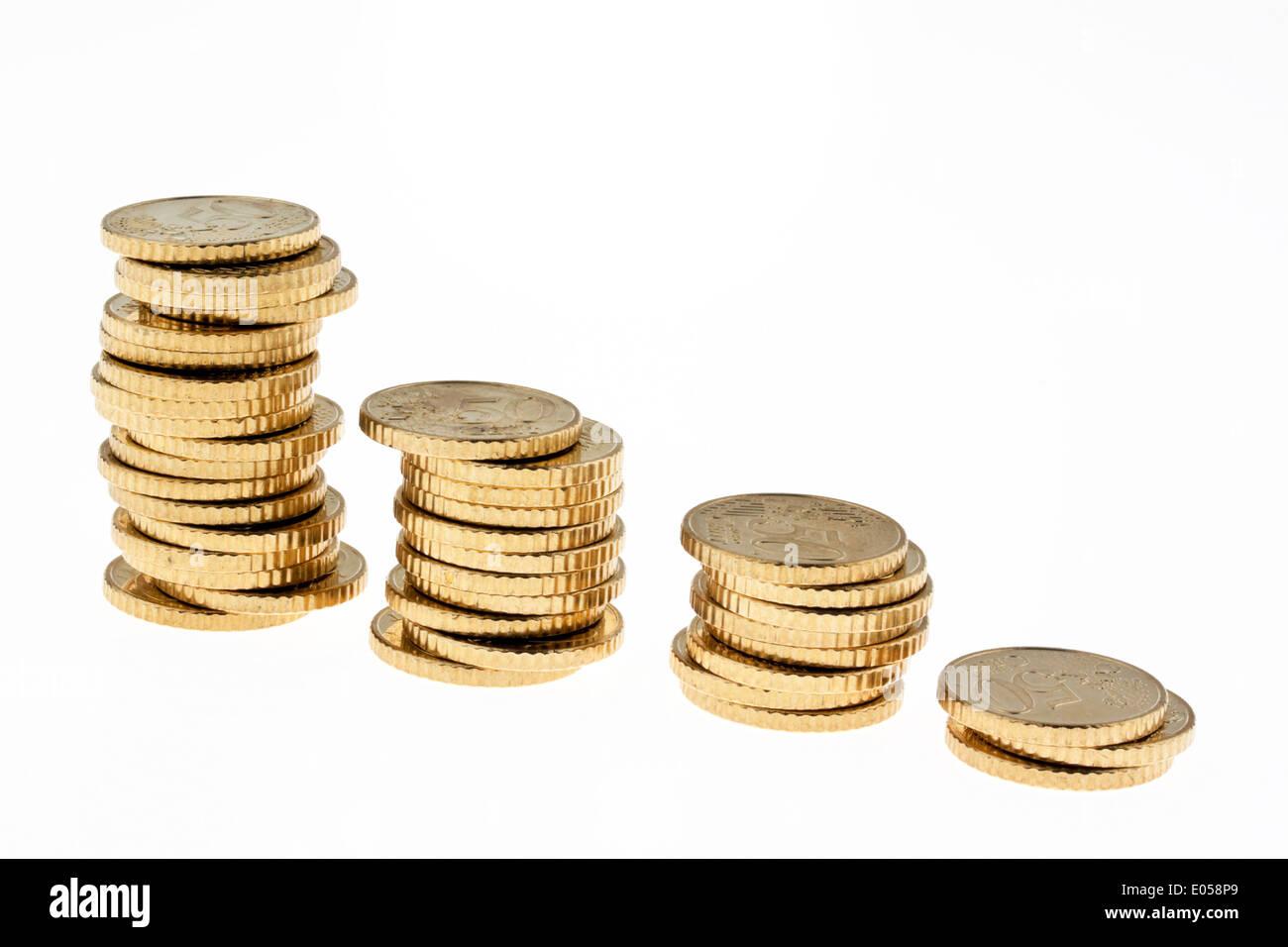 Several coin piles of eurocoins. Isolated on white background, Mehrere Muenzstapel von Euromuenzen. Isoliert auf weissem Hinterg - Stock Image