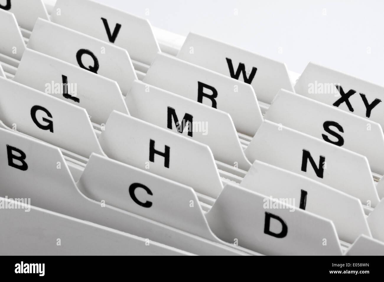 A white card index map box with alphabetical assortment, Ein weisser Kartei Kartenkasten mit alphabetischer Sortierung - Stock Image